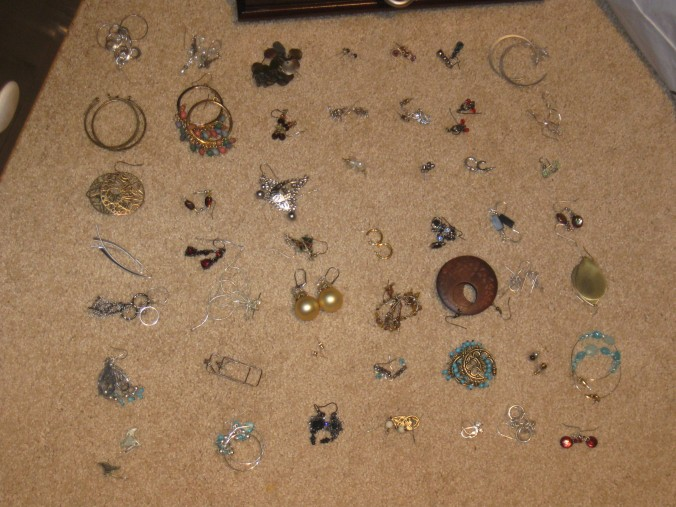 There are 49 pairs of earrings here.