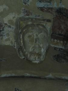 Close-up on a face in the ceiling.